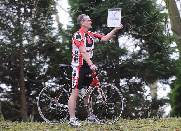 Triathlete Tony Redmond with his award