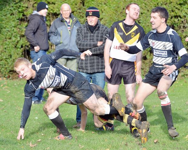 Wyke's player-coach Ian Wormald, seen scoring a try against Odsal Sedbergh, is fed up of losing to Sharlston Rovers