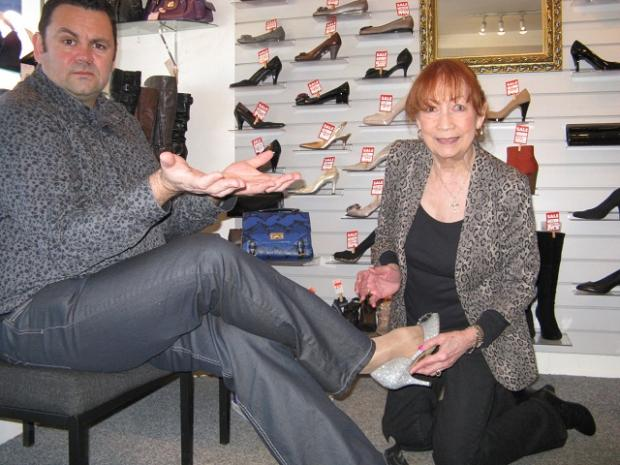 Yeadon  Amateurs' Andrew Walton            trying on shoes at Tip Toes with owner Joan Walsh