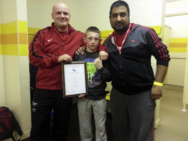 Callum Grace shows off his Yorkshire winner's certificate with coaches Andy Grocutt and Kadir Khan