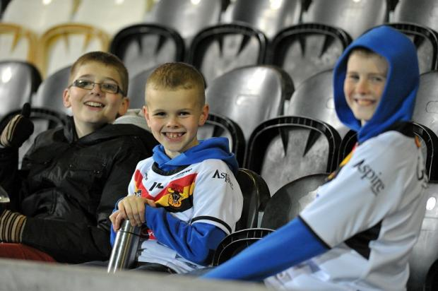 Young Bulls fans wait patiently but ultimately in vain for the match at Hull to kick off
