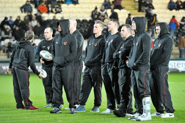 Bulls players stand on the KC Stadium pitch prior to the postponement of the game against Hull