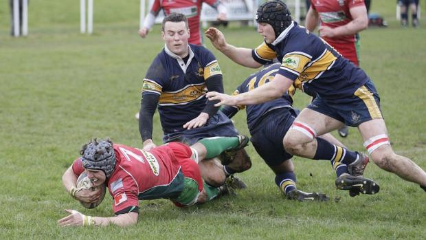 Three Old Crossleyans defenders cannot stop flanker Scott Dyson from crashing over for Keighley. Picture: Charlie Perry