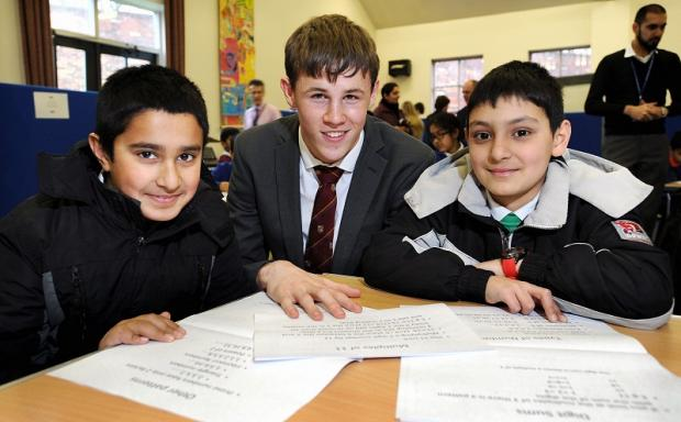 Pictured at the maths masterclass are, from left, Yusuf Mansoor, Harry Petyt and Sulair Mahammed