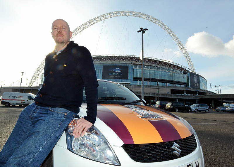 City reporter Simon Parker with the Bantams Suzuki car at Wembley