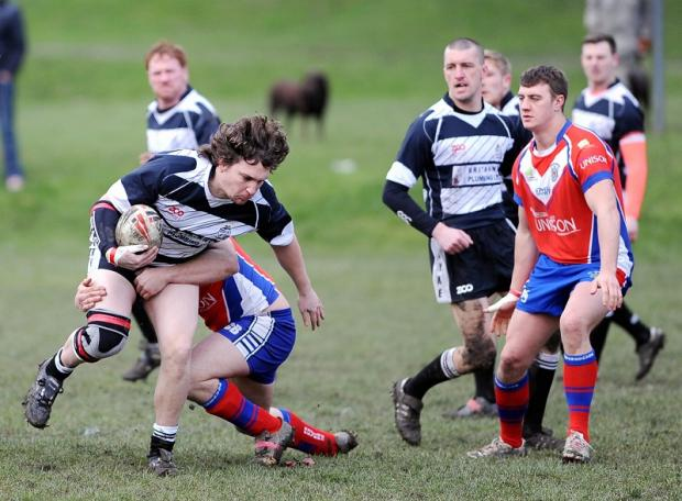 Wyke replacement Barry McShera drives forward for Wyke against Sharlston Rovers