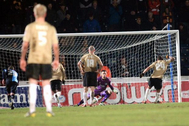 Nathan Doyle tucks away a penalty for his second goal of the game