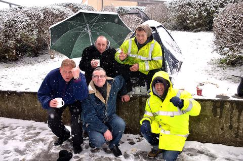 These Bradford City fans queue in the snow today ahead of the last Cup Final tickets going on sale at Valley Parade tomorrow