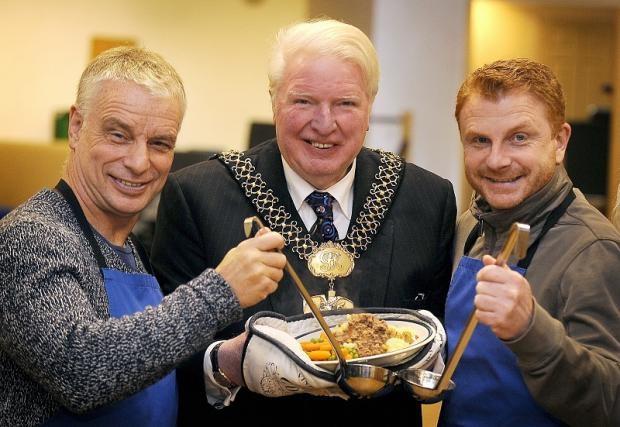 Lord Mayor Councillor Dale Smith (centre) with Brian Noble (left) and Wayne Jacobs serving up food at St Mary's Church Immanuel Project