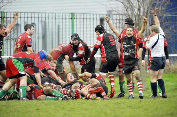 Ollie Akroyd, fifth left with black mouthguard, celebrates scoring a try against Keighley earlier this season