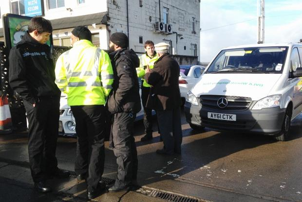 Faheem Rehman (third from left) argues with police and DVLA officials