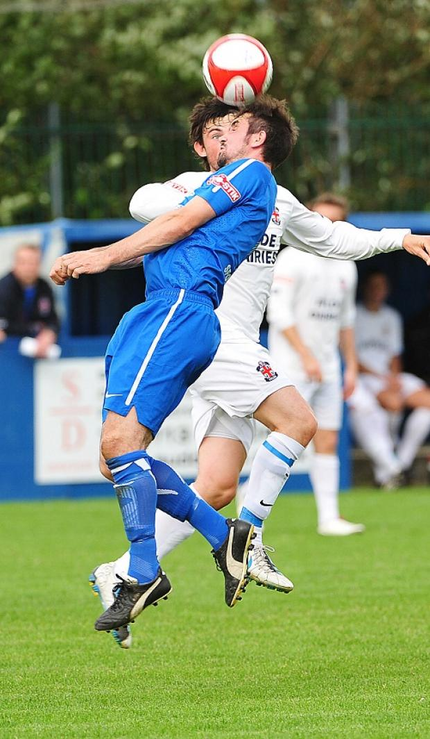 Dave Briggs, seen outjumping Fylde's Joe Booth, is Farsley's only long-term injury absentee with a hernia problem