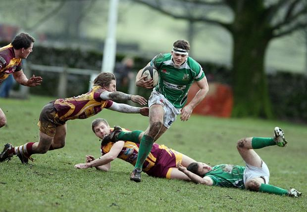 ON THE RUN: Wharfedale's James Tinknell leaves Tigers' defence trailing in his wake