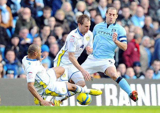 Rodolph Austin and Luke Varney gang up to halt Pablo Zabaleta