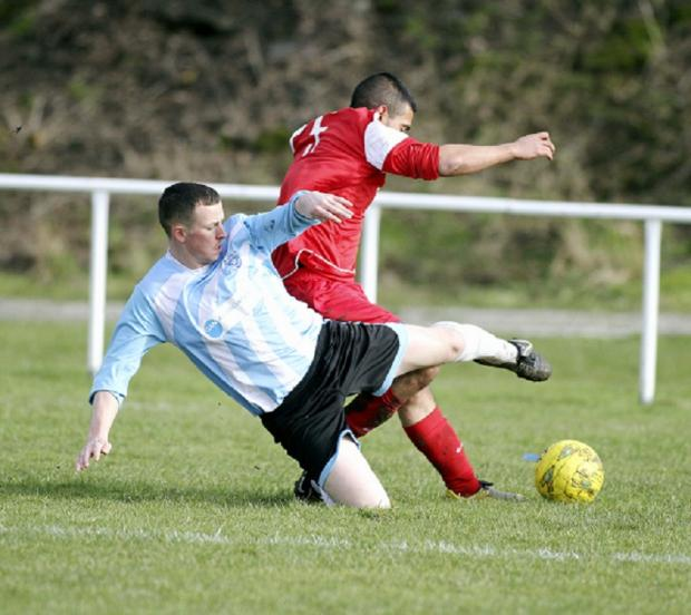 Dom Creed, left, goes in hard for Silsden Whitestar in their dramatic Keighley & District FA Challenge Cup semi-final against Manningham All Stars, which Silsden won 5-4 on penalties after a 4-4 draw at the end of extra-time