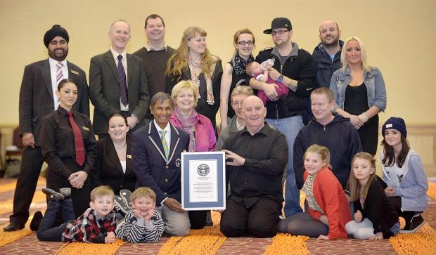 The Little Heroes group with their Guinness World Records certificate for the longest string of beads