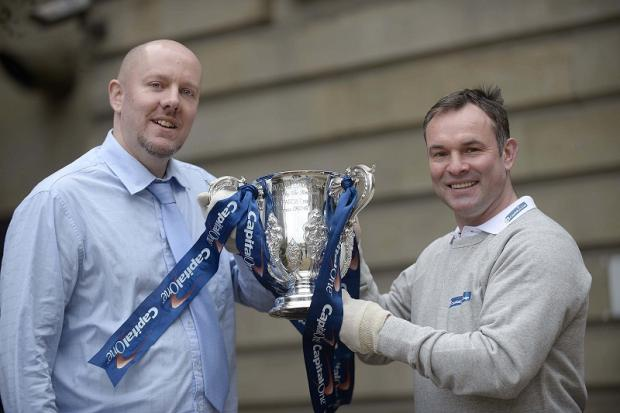 City reporter Simon Parker and Peter Beagrie get their hands on the Capital One Cup