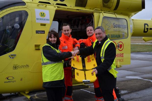 Ferno staff visit the Yorkshire Air Ambulance base to present the money