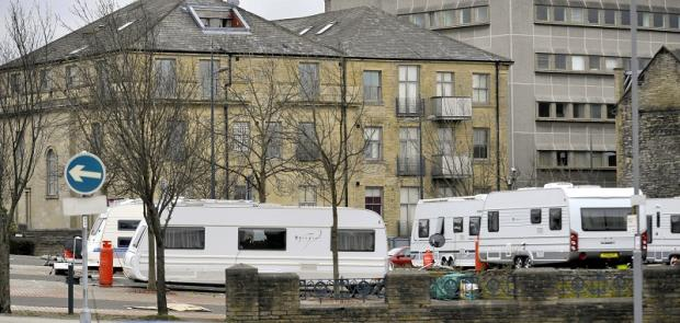 Travellers on the pay and display car park at the top of Little Germany