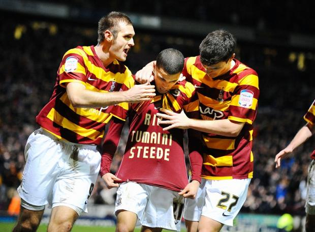 Nahki Wells reveals his tribute t-shirt after scoring against Aston Villa