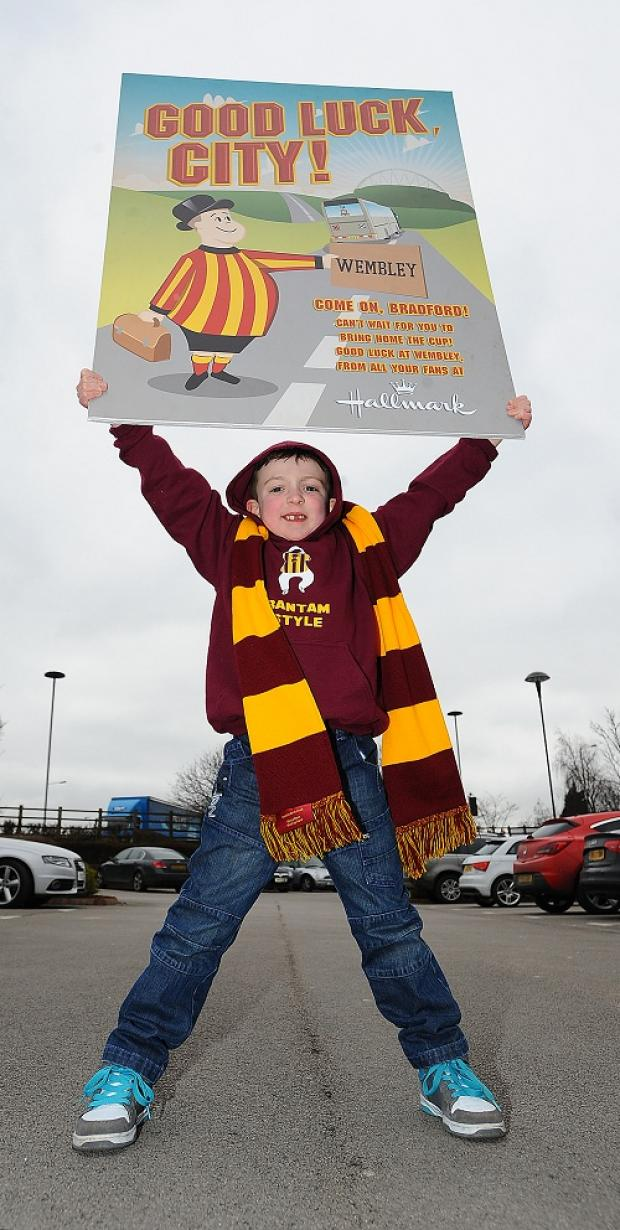 Finlay Thomas, aged six, from Queensbury holds a giant card