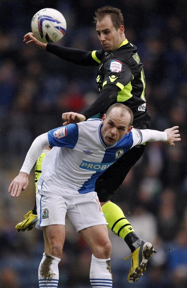 Luke Varney outjumps Blackburn's Danny Murphy during Leeds' impressive display at Ewood Park