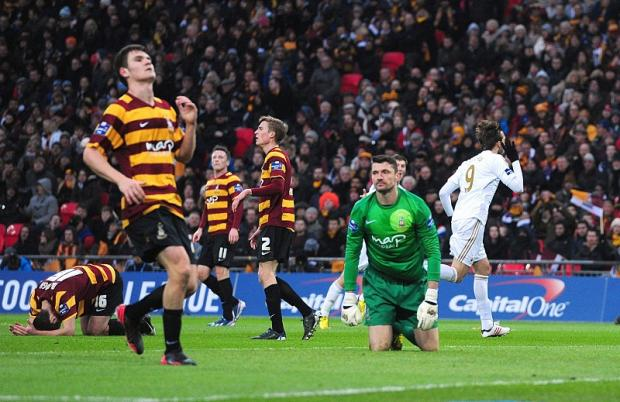 Bradford Telegraph and Argus: Miguel Michu, right,  scores Swansea's second goal but things were to go from bad to worse for City keeper Matt Duke