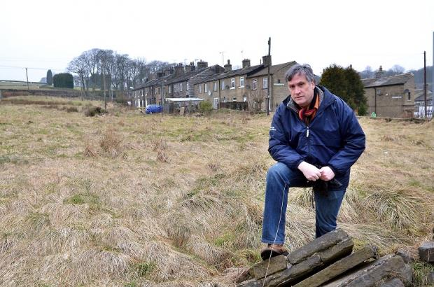 Councillor Simon Cooke at the site of the proposed development in Denholme