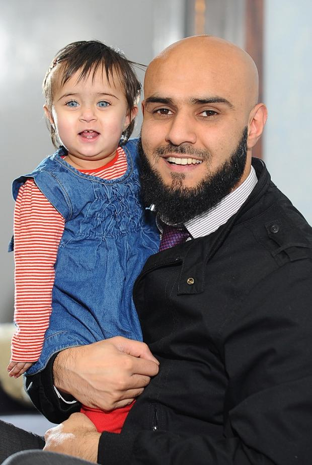 Proud dad Imran Fazil with his daughter one-year-old Aisha Siddiqa born on the leap year day of Feburary 29 last year