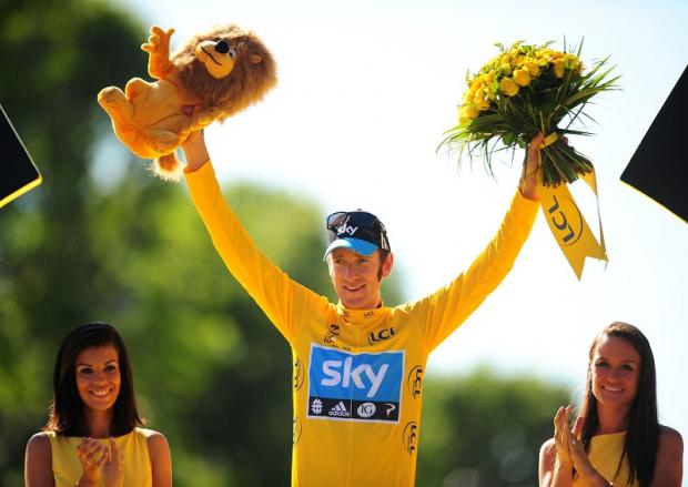Reigning Tour De France champion Bradley Wiggins celebrates his victory in 2012