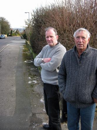 Trevor Peel (left) and John Murgatroyd. Right, one of the messages to dog owners on Brantcliffe Drive, Baildon