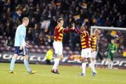 James Hanson celebrates his equalising goal with City team-mate Kyel Reid