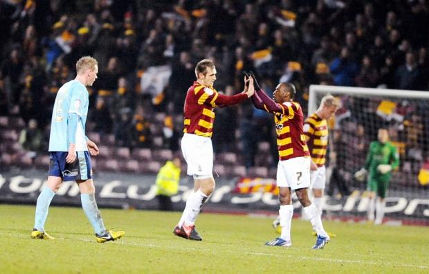 Bradford Telegraph and Argus: James Hanson celebrates his equalising goal with City team-mate Kyel Reid