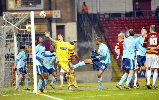 Dagenham goalkeeper Chris Lewington is left grasping at thin air as City go close to scoring