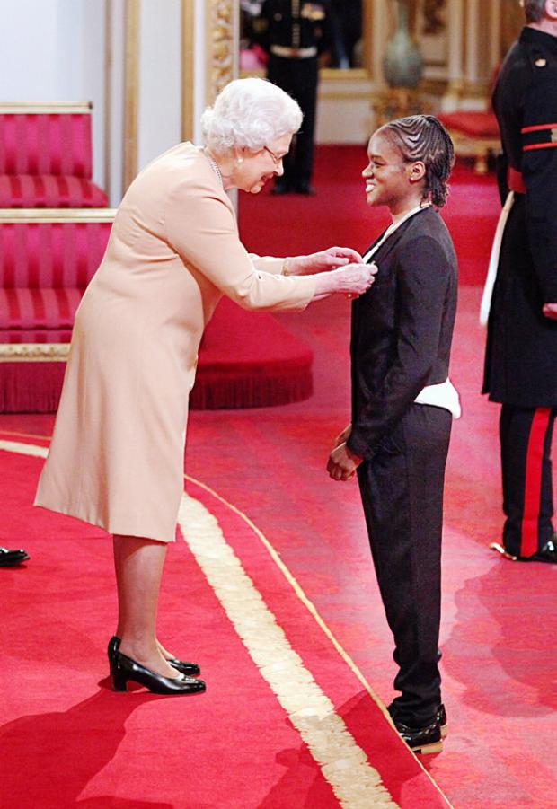 Nicola Adams receives her MBE medal from the Queen