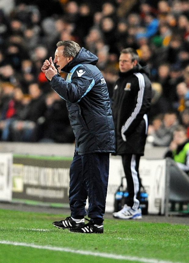 Neil Warnock wants Leeds United to be in with a shout of the play-offs with ten games remaining