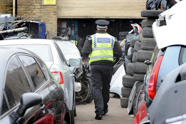 Police raid a suspected 'chop shop' in Spencer Road, Lidget Green, as part of Operation Squadman