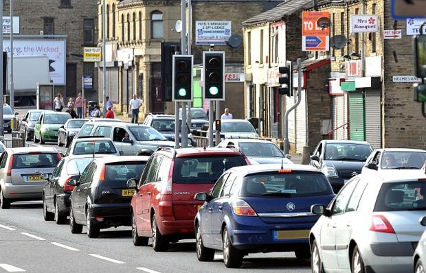 Improving transport links could prevent congestion, seen here in Tong Street, Holme Wood