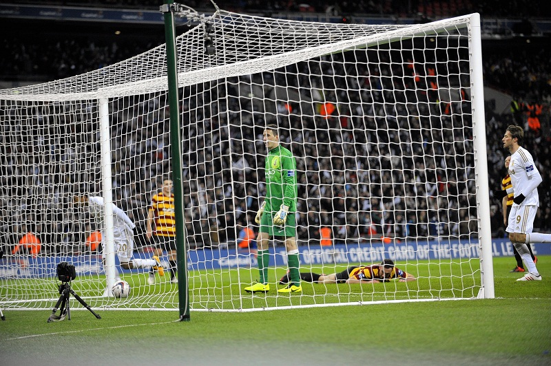 Jon McLaughlin walks to pick the ball out of the net after coming on as a Wembley substitute