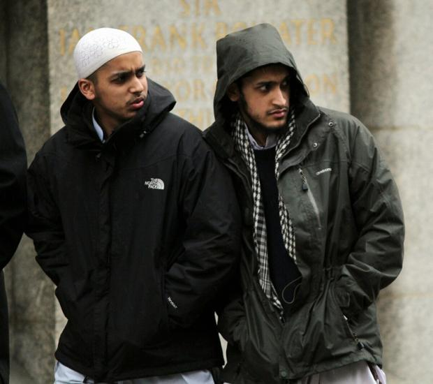 Bradford brothers Muhammed  Naeem Ahmed (left) and Muhammed Saeed Ahmed outside The Old Bailey in London