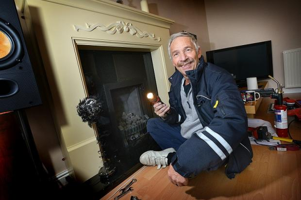 Gas fitter Ray Baxter who had to replace the fire place after a cut got stuck up it