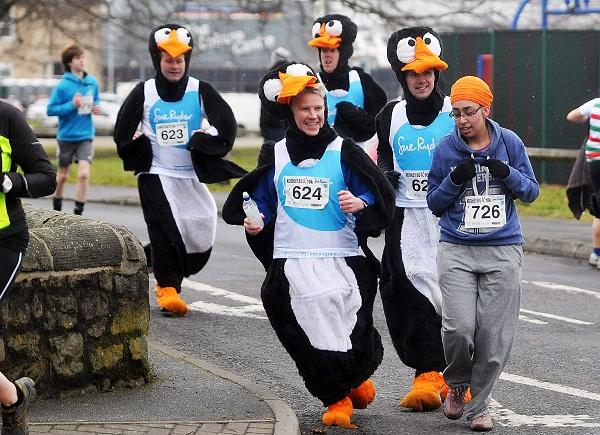 Team Penguin gets into its stride during the Keighlery 10k today