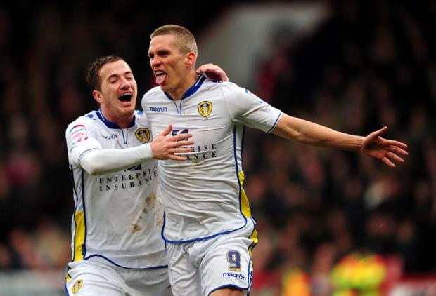 Leeds United's Steve Morison, right, celebrates his opening goal with Tom Lees