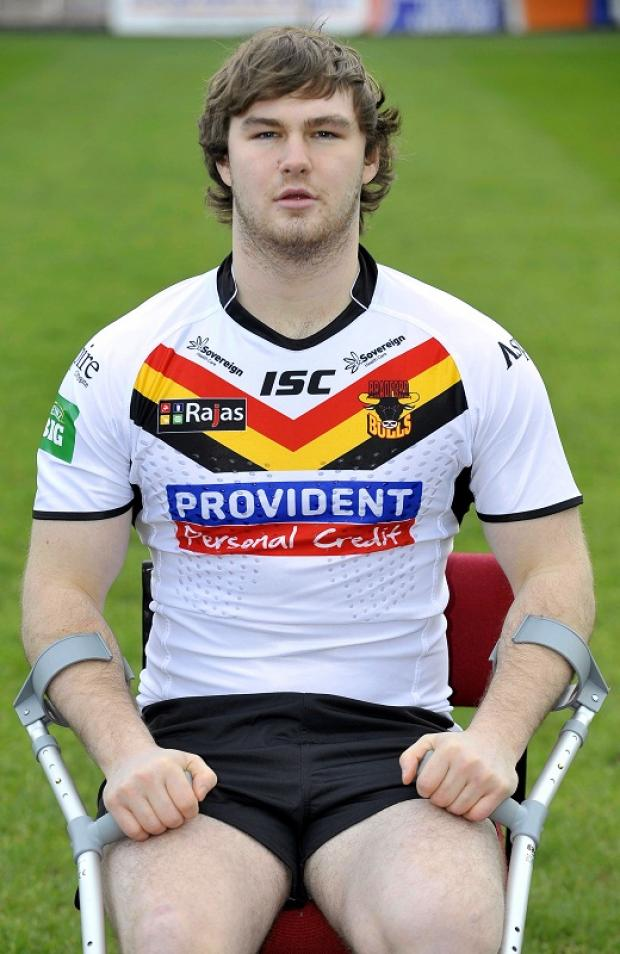 Ben Evans complete with crutches at the Bulls' pre-season photocall