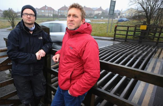 Residents Greg Edgley (left) and Stuart Lancaster at the site of the cattle grid