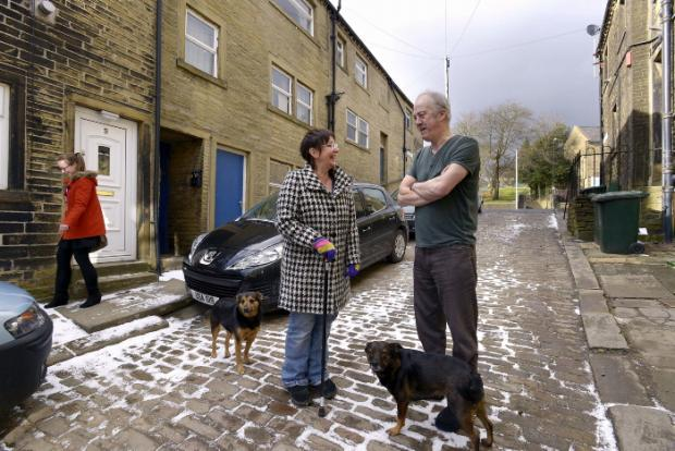 Residents Stan Bateman and Elli Luha chat in Bradford's aptly-named Friendly Street