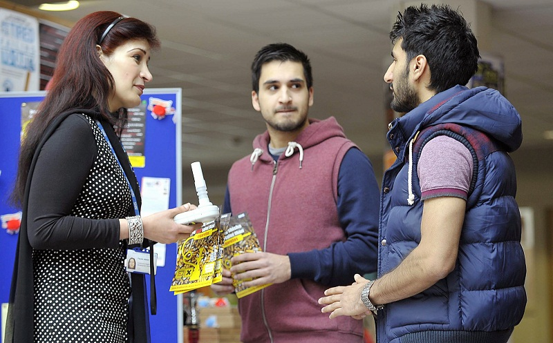 An awareness event for national No Smoking Day was held at Bradford University. Pictured discussing the dangers of cigarettes and shisha pipes are (from left) Fauzia Jabeen and students Umar Khan and Khurran Munir