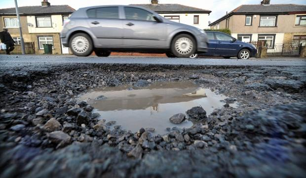 Bradford Council spent £215,000 filling in potholes in the district last year