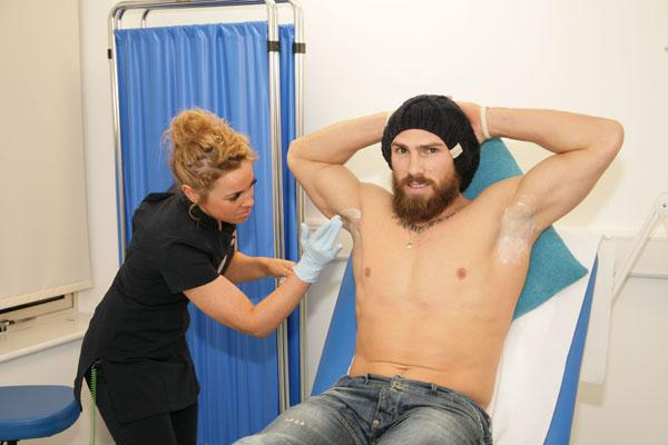 Jarrod Sammut gets ready to have his underarms treated with Botox