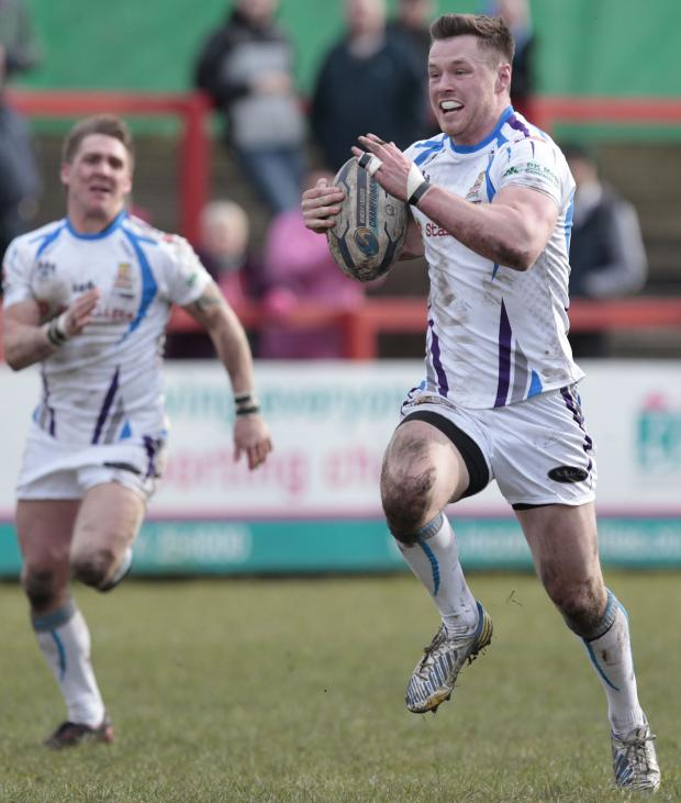 Elliott Cosgrove shows his joy as he runs in for a try against York City Knights. Picture: Charlie Perry